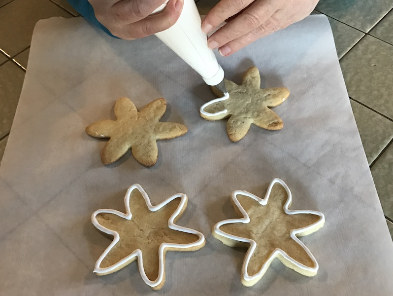 Outline sugar cookies with royal icing