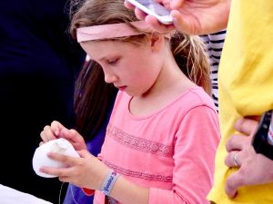 Girl sewing a Sugar Push Marshmallow at the San Mateo Maker Faire