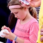 Young girl sews Sugar Push Marshmallow at San Mateo Maker Faire 2017